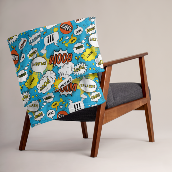 Comic Bubbles Throw Blanket Folded on Chair